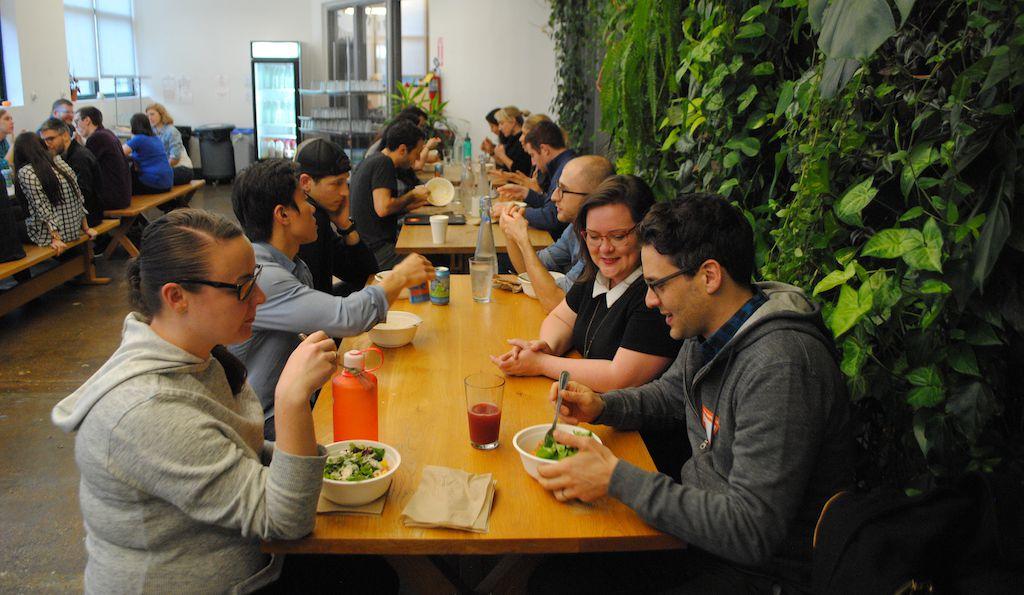 Etsy employees enjoy a meal