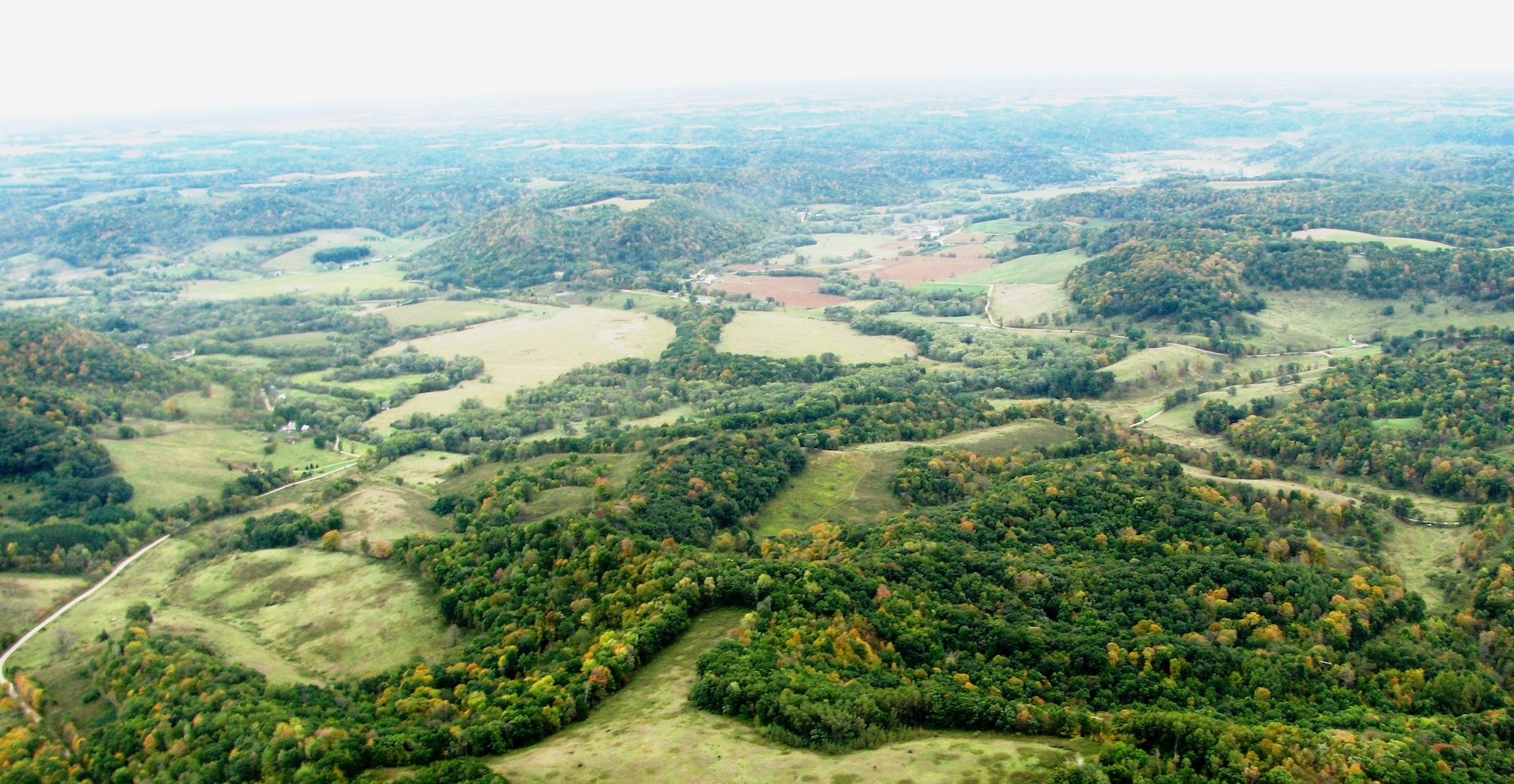 An aerial shot of Tunnelville Road in La Farge, WI—home to Organic Valley's national headquarters—shows the Driftless Area's characteristically hilly terrain