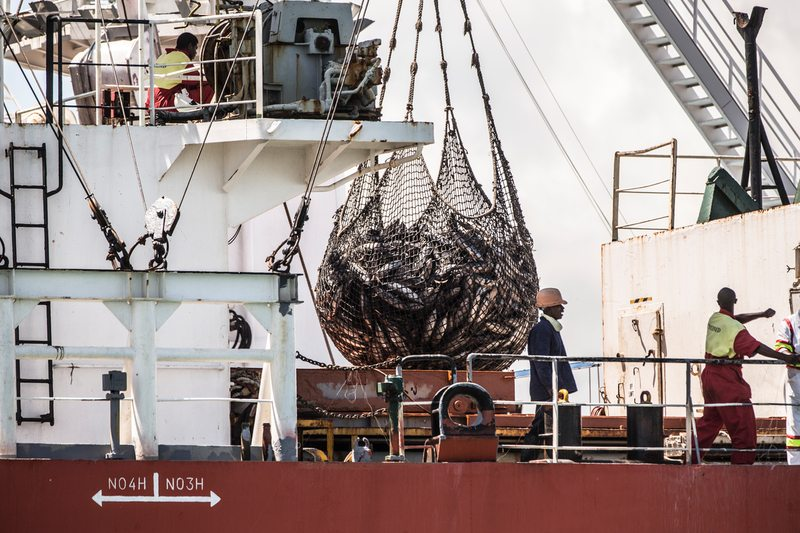 Spanish purse seiner transship tuna to the reefer vessel Retriever in the port of Diego, Madagascar