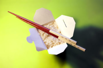 takeout container of rice and chopsticks
