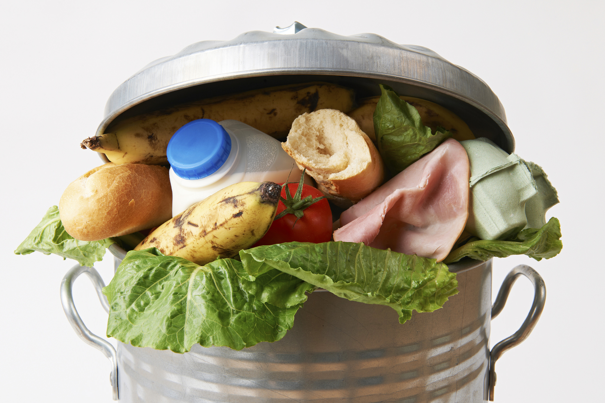 Garbage can brimming with food waste