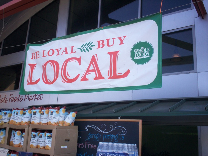 Sign advertising local goods at Whole Foods