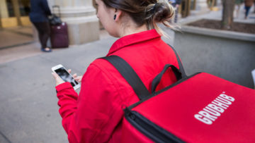 A Grubhub driver uses the GrubHub delivery app