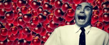 bald man is horrified by red delicious apples