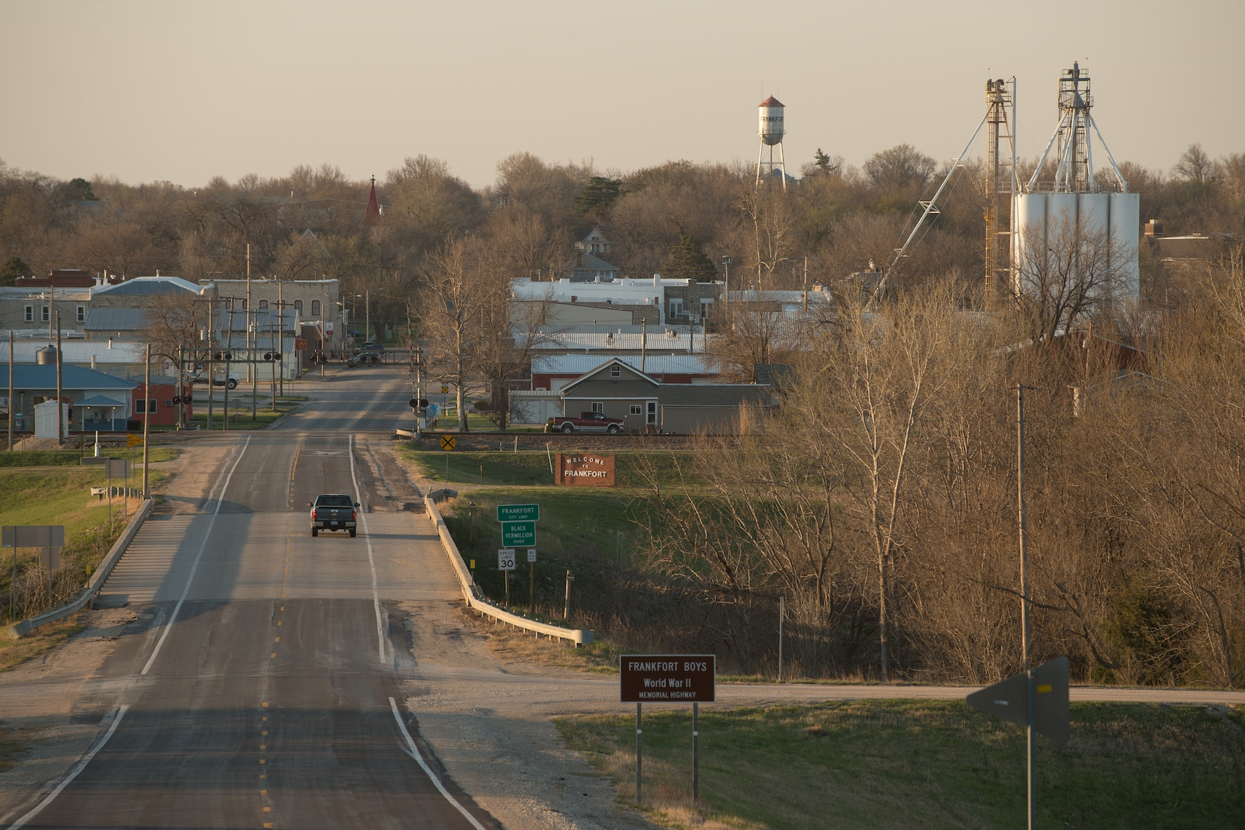 Frankfort, Kansas, looking straight down Main Street. Pictured are the main rail lines, grain elevators, old water tower, and church steeple popping up from the trees