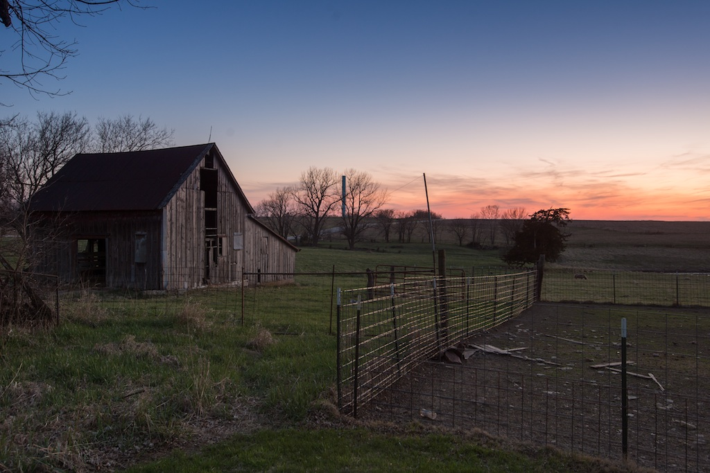 Kansas rural depopulation: old barn, and agricultural pen, May 2018