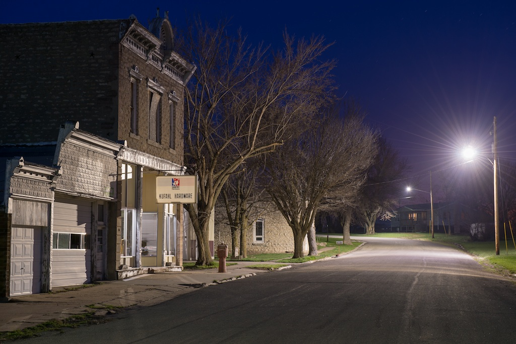 A street in rural Courtland, Kansas is a picture of the rural life that once was for commodity grain farmers