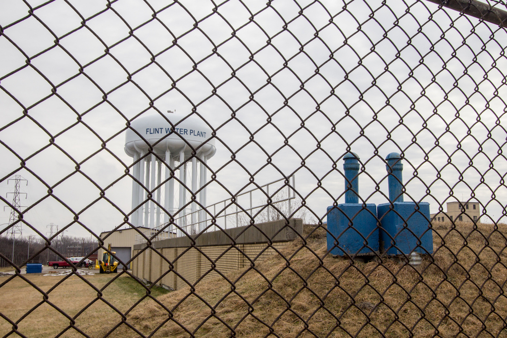 Flint Michigan Water Tower Through Chain Link Fence