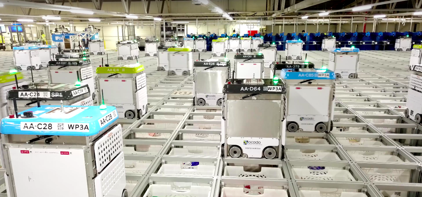 Ocado's e-commerce business runs off of robots like these, which zoom around fulfilling orders in its warehouses