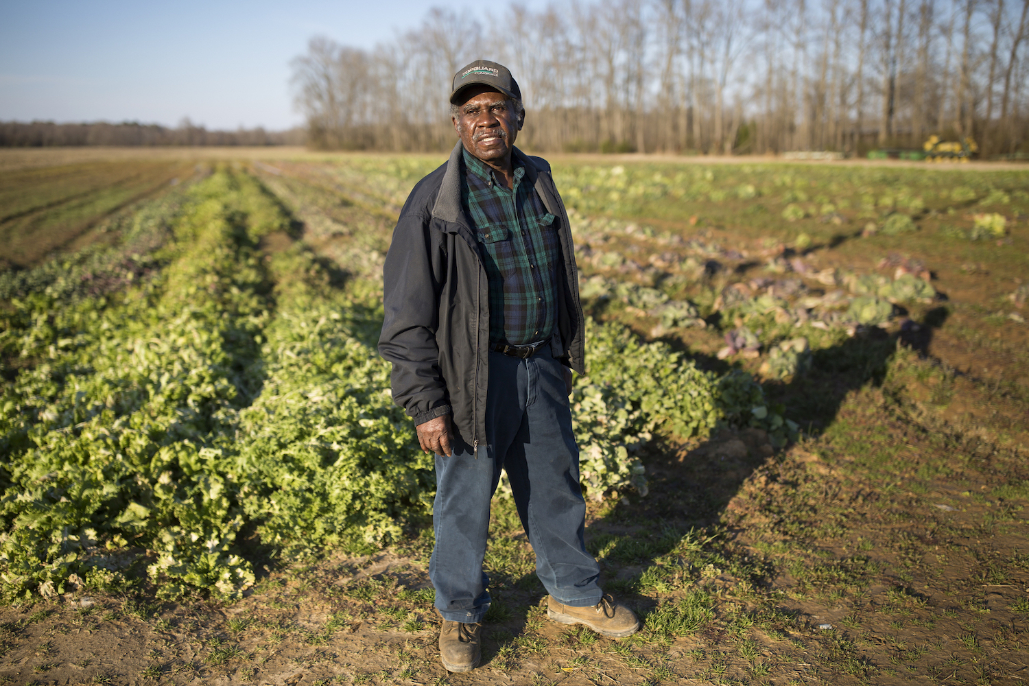Former extension agent Haywood Harrell stands on his farm in Tillery, North Carolina