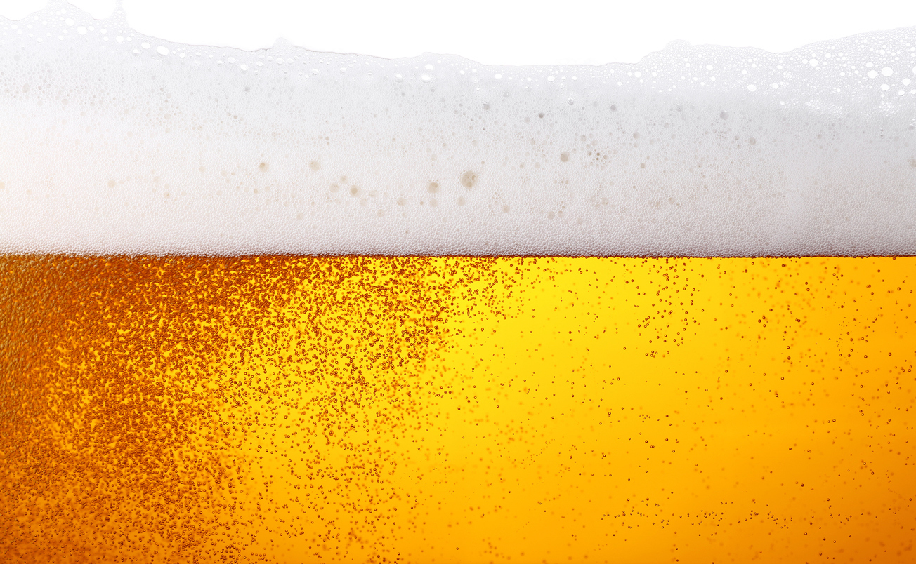 Close up background texture of lager beer with bubbles and froth in glass