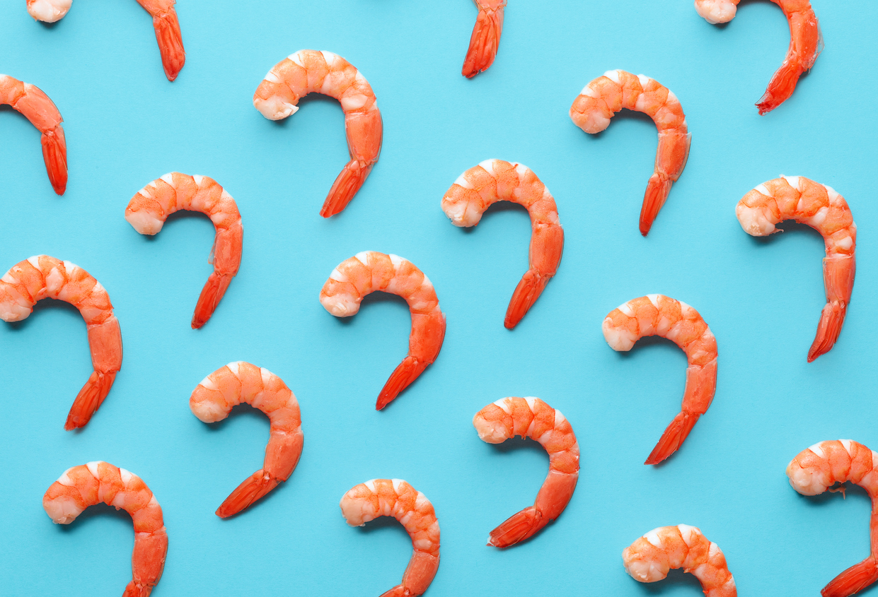 Pattern of boiled prawns on blue background.