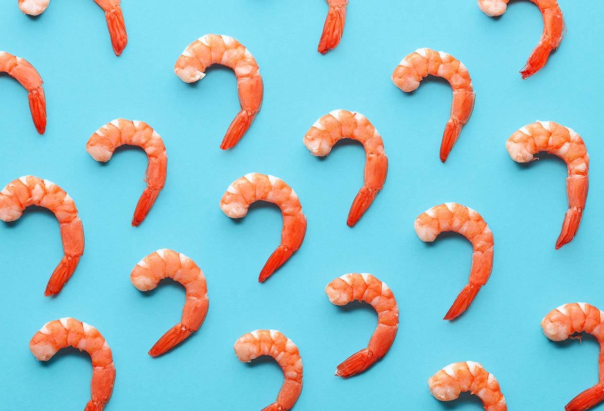 Pattern of boiled prawns on blue background.