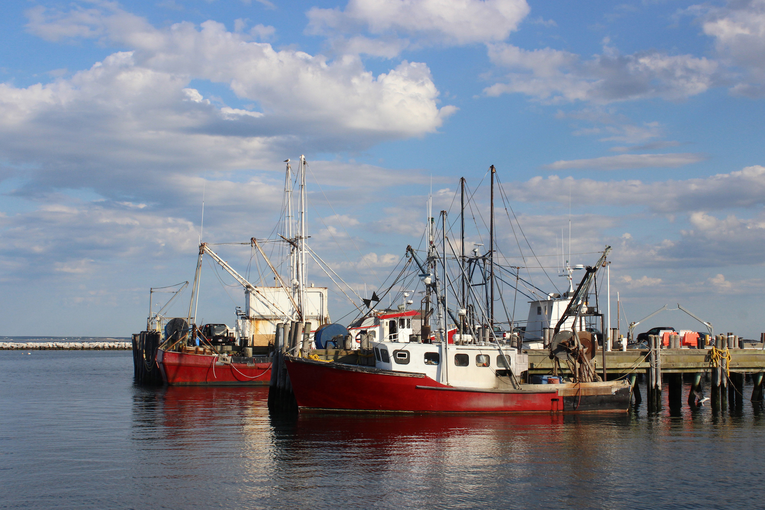 Red fishing boats docked