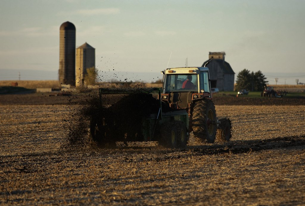 tractor applies biosolids, or sewage sludge, to a farm