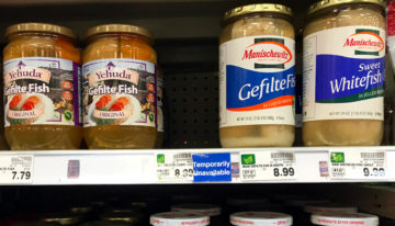 During the covid-19 epidemic, the author is weightlifting with cans of gefilte fish