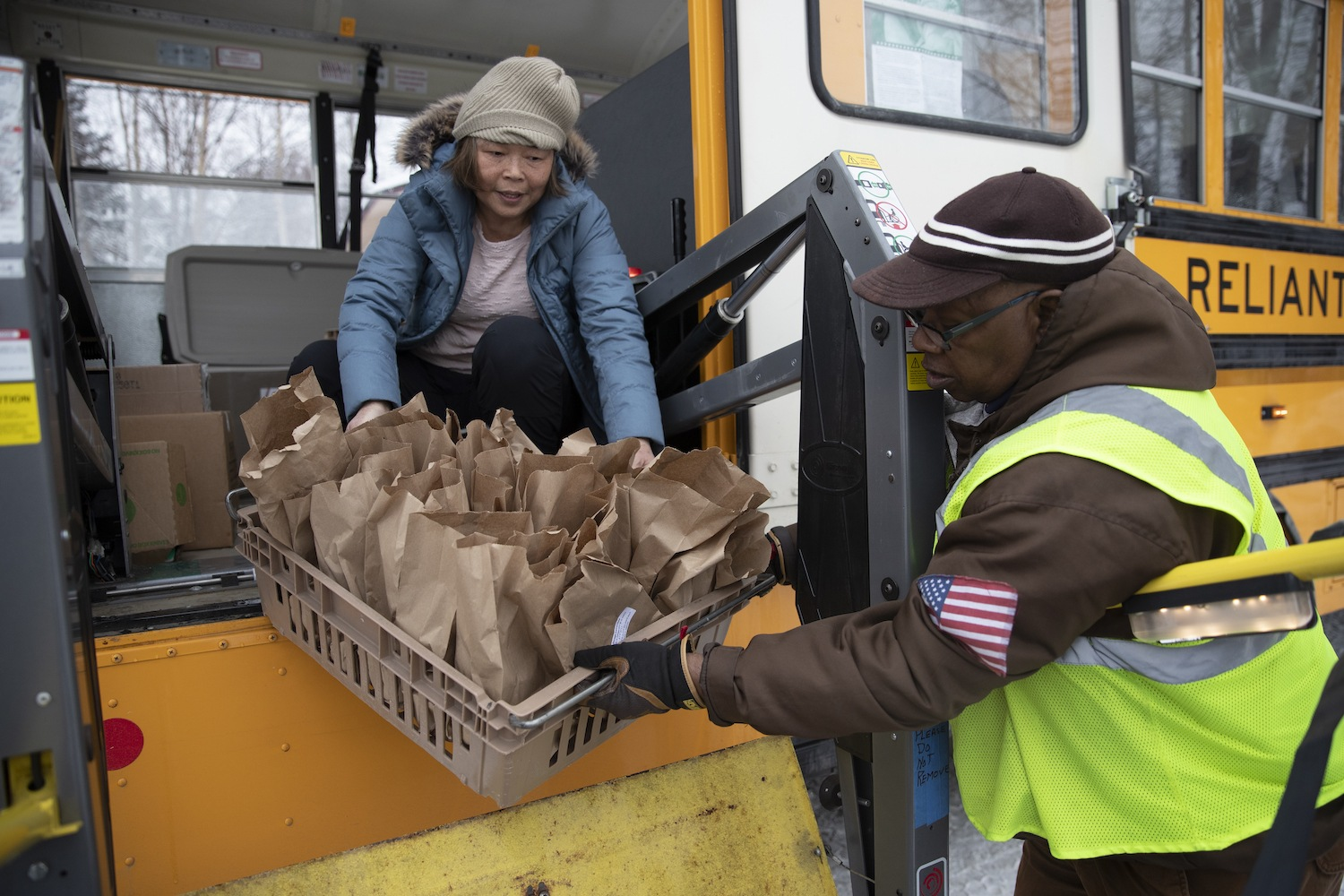 Anchorage school district employees unload food for students April 2020