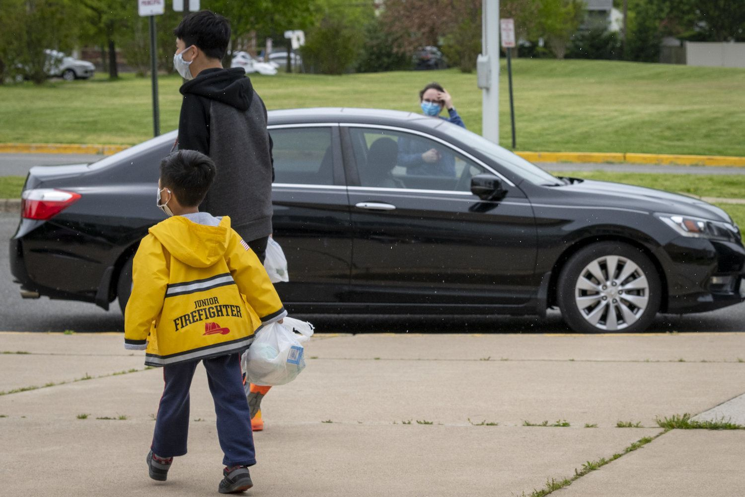 A family picks up a grab-and-go meal in Arlington, Virginia.