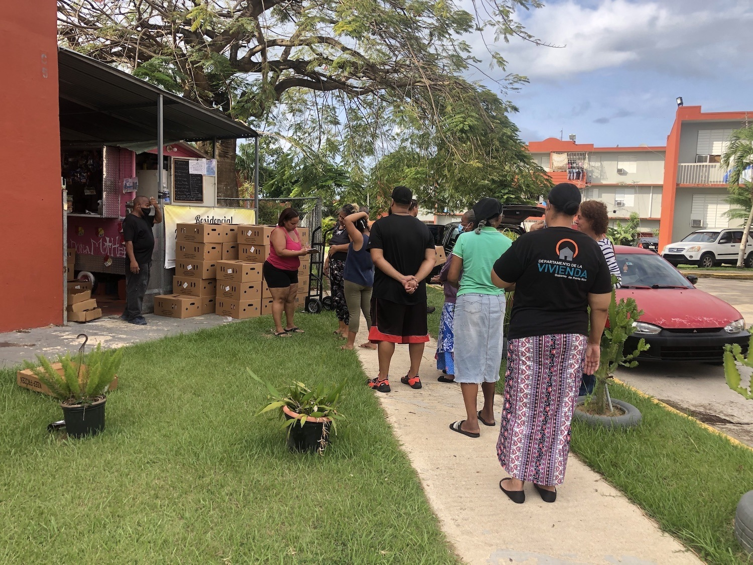Residents of the Manuel A. Perez Housing Project in San Juan, Puerto Rico, line up to receive food boxes June 2020