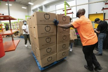 Houston Food Bank workers transporting SNAP fruit and veggie boxes, September 2020