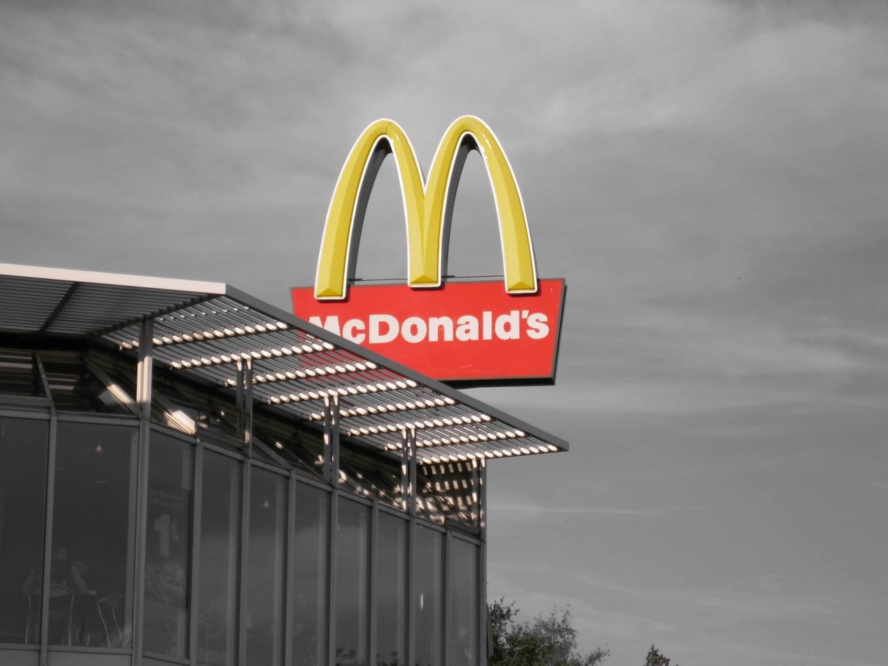 Mcdonald's sign in color with grey sky. September 2020