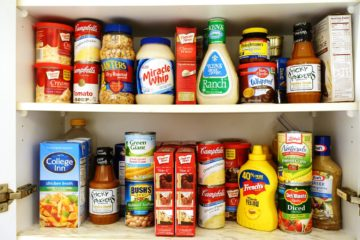 kitchen pantry shelves filled with canned goods and nuts and condiments September 2020