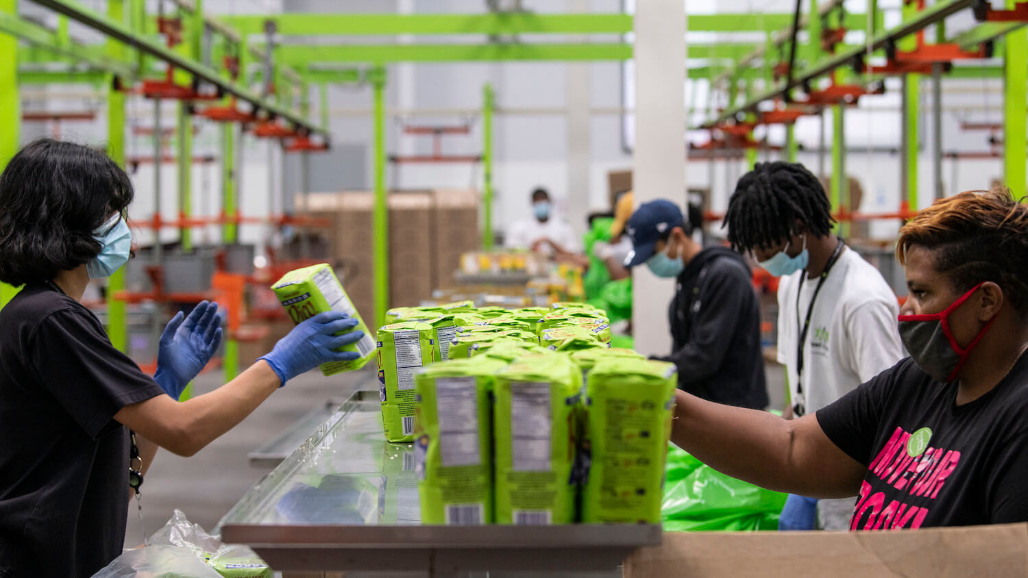 Workers pack food for the Farmers to Families Food box Program at the Houston Food Bank. September 2020