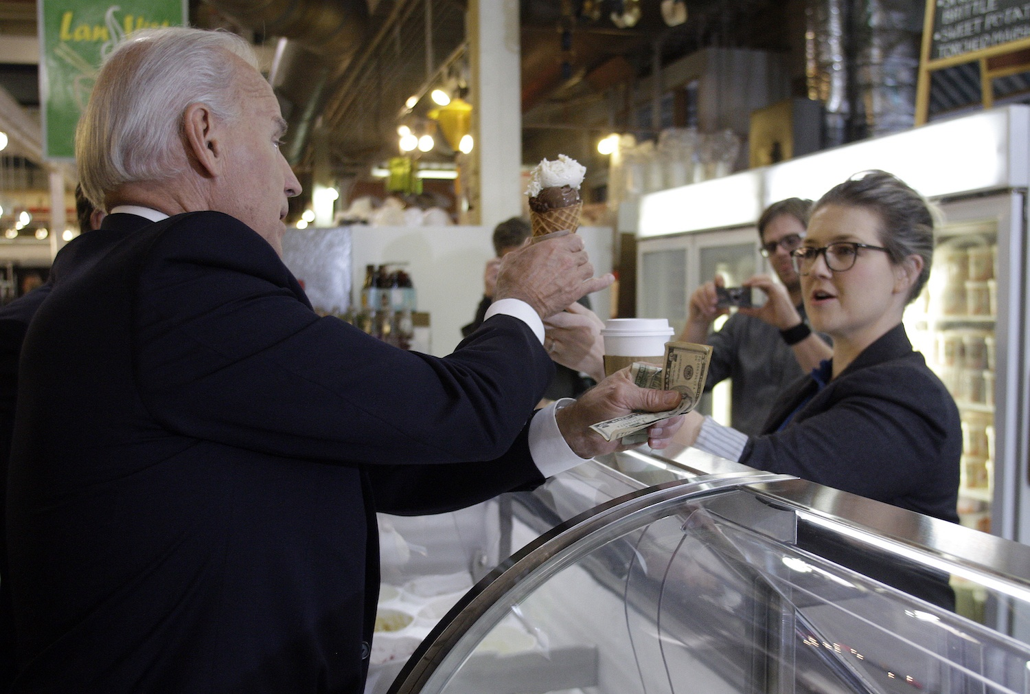 Joe Biden, left, buys a double scoop ice cream cone from Jeni's Ice Cream owner Jeni Britton Bauer at North Market in downtown Columbus, Ohio during the 2012 campaign.