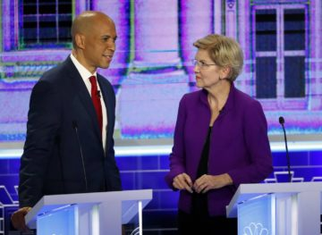Democratic presidential candidates Sen. Cory Booker, D-N.J., talks with Sen. Elizabeth Warren, D-Mass., right, before the start of a Democratic primary debate hosted by NBC News at the Adrienne Arsht Center for the Performing Art, Wednesday, June 26, 2019, in Miami.