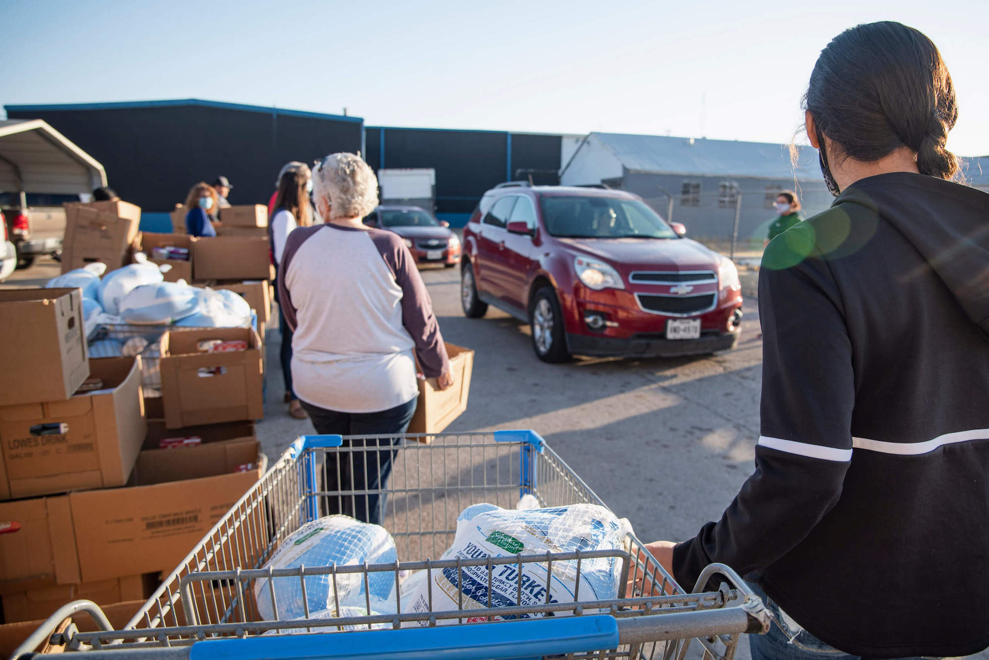 Volunteers wait to distribute food boxes on Friday, Nov. 20, 2020 in Odessa, Texas.