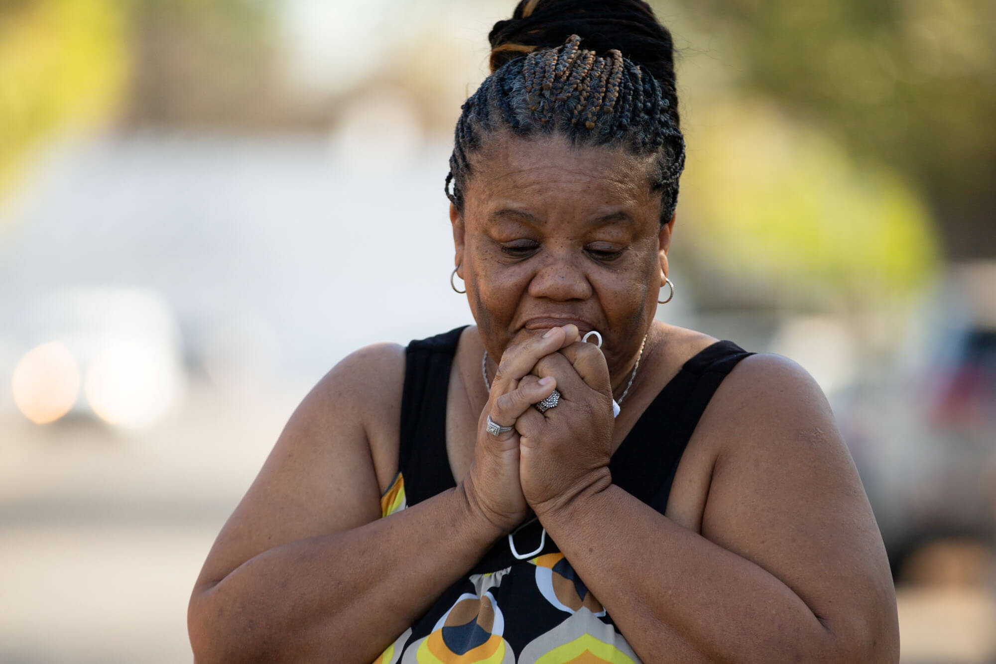 Deborah Bell-Holt stands outside of her home in Jefferson Park near Downtown Los Angeles on Jan. 21, 2021. Having fallen deeper into utilities debt as she took in family and friends during the pandemic, Bell-Holt fears her water will be shut off.
