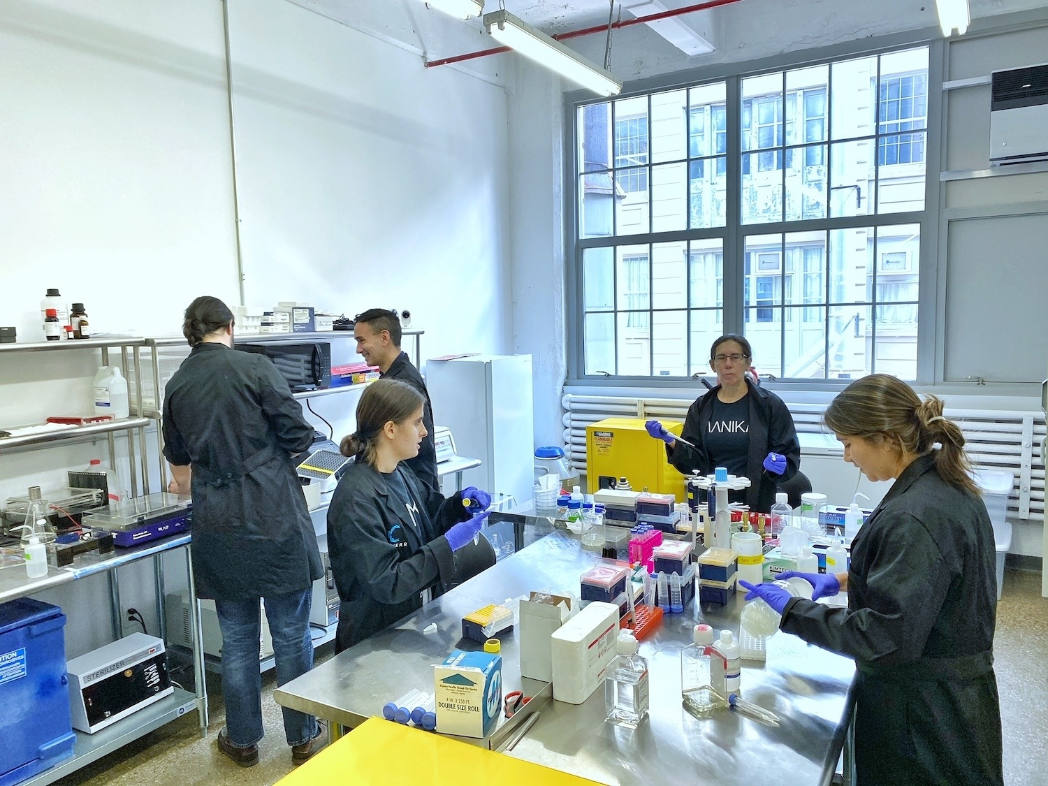 Aanika Biosciences employees working in the company's laboratory, located in Brooklyn. January 2021