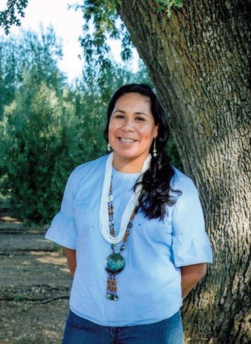 A-dae Romero-Briones portrait in front of tree. May 2021
