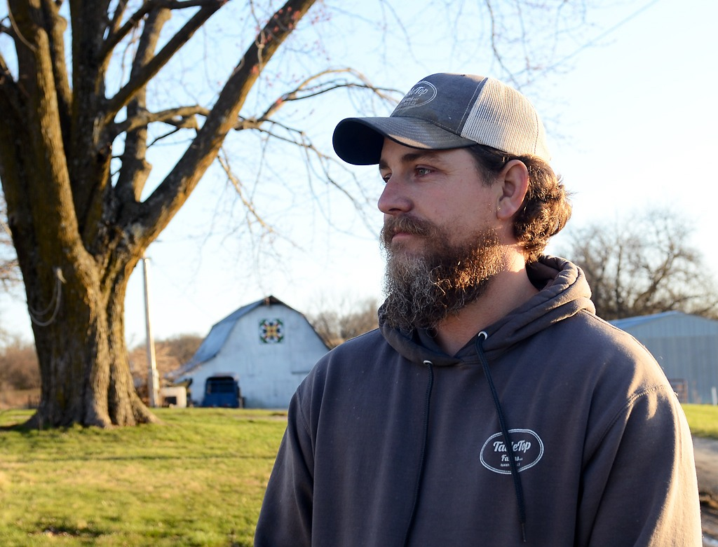 Andrew Geiser stands on his family's 100-year-old farm on Friday, March 19, 2021, in Chillicothe, Mo.