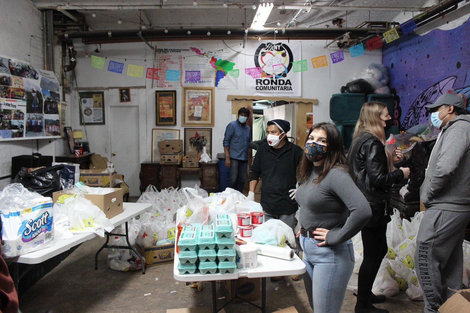 Volunteers working at the food distribution rally at the Red de Pueblos Transnacionales headquarters in the South Bronx on March 20. Volunteers were both from Red de Pueblos Transnacionales and the American Indian Community House. March 2021