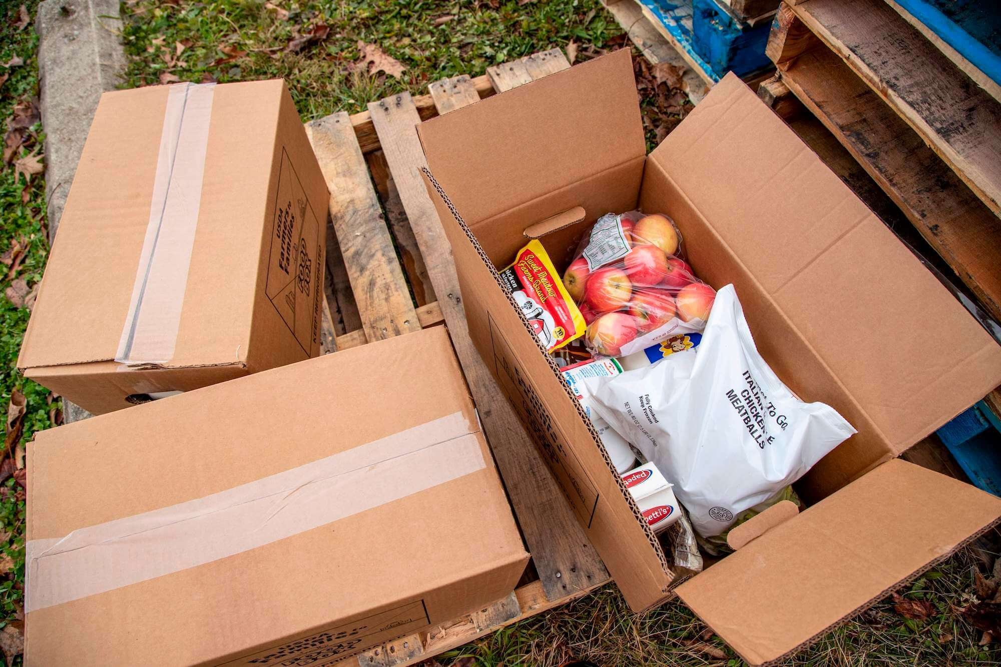 Contents of a USDA Farmers to Families food box includes apples meatballs, hotdogs, milk and other fresh items that need to be consumed in a timely manner in Athens, Ohio on December 19, 2020. - Thousands of food boxes were distributed to families from all over rural Appalachia who were able to drive to the fairgrounds, but most only were able to leave with one box of food for the week of Christmas. April 2021