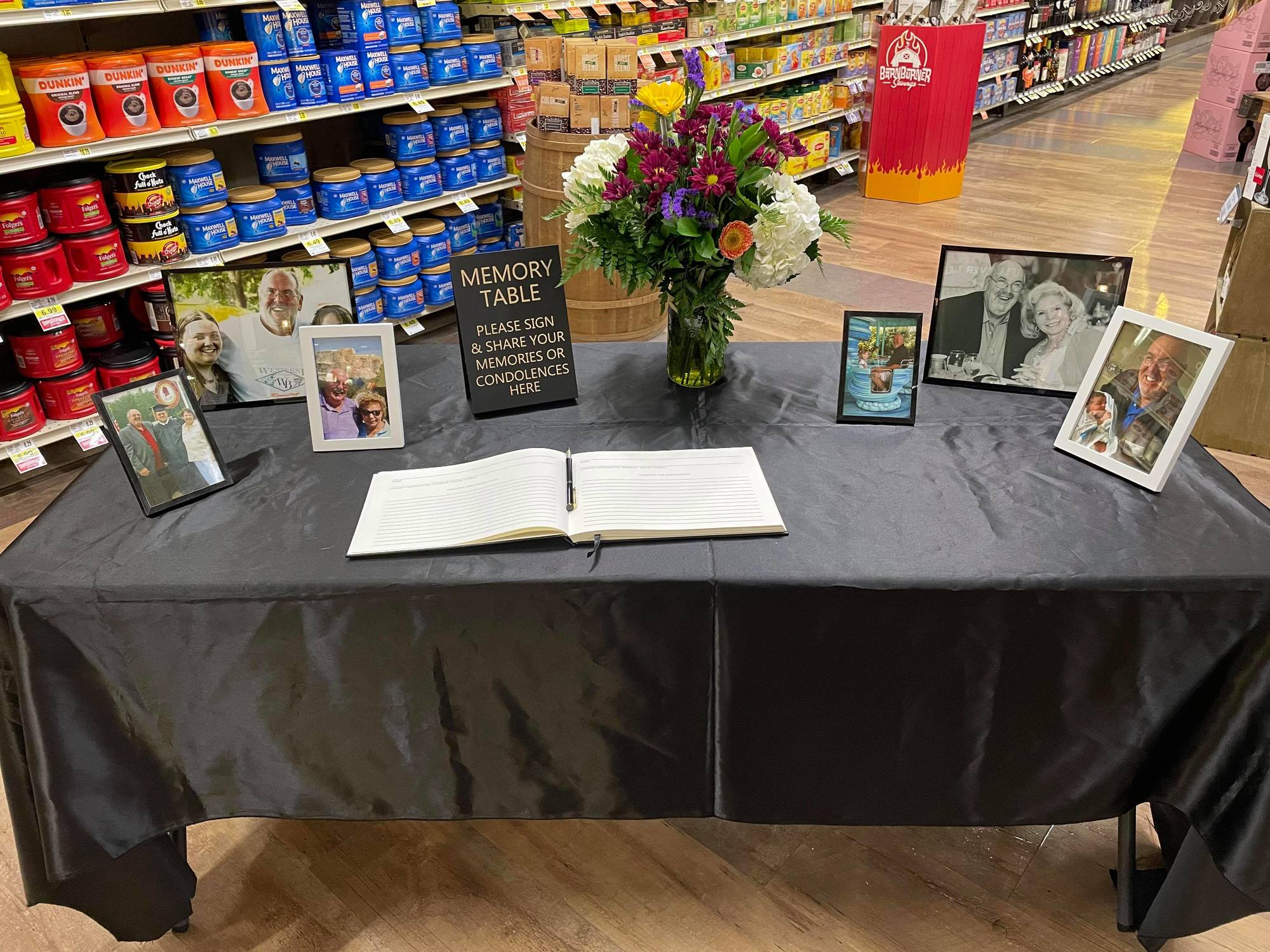 A memorial table for Mark Terry in Lowes Foods in Winston-Salem, North Carolina. June 2021