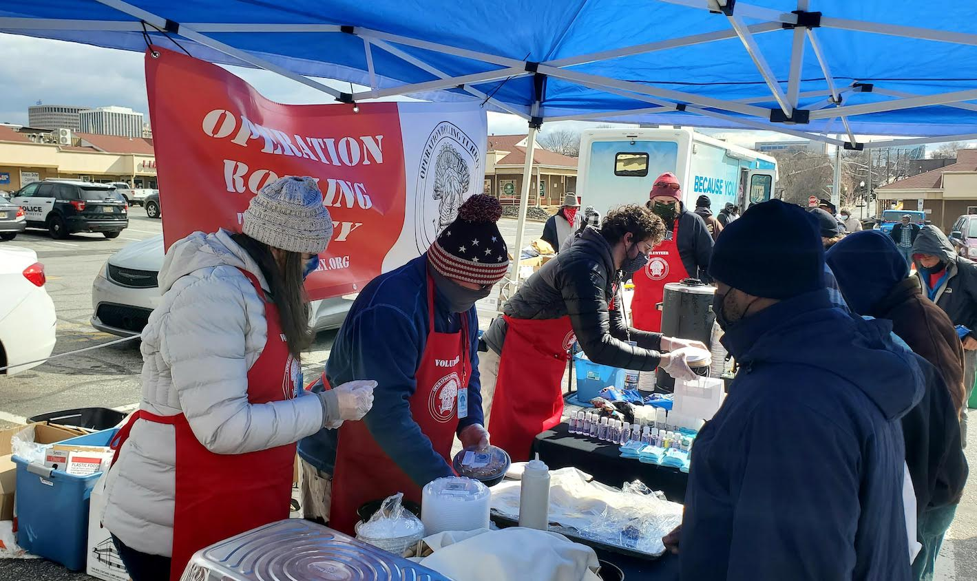 Volunteers pass out meals for Operation Rolling Turkey. November 2020