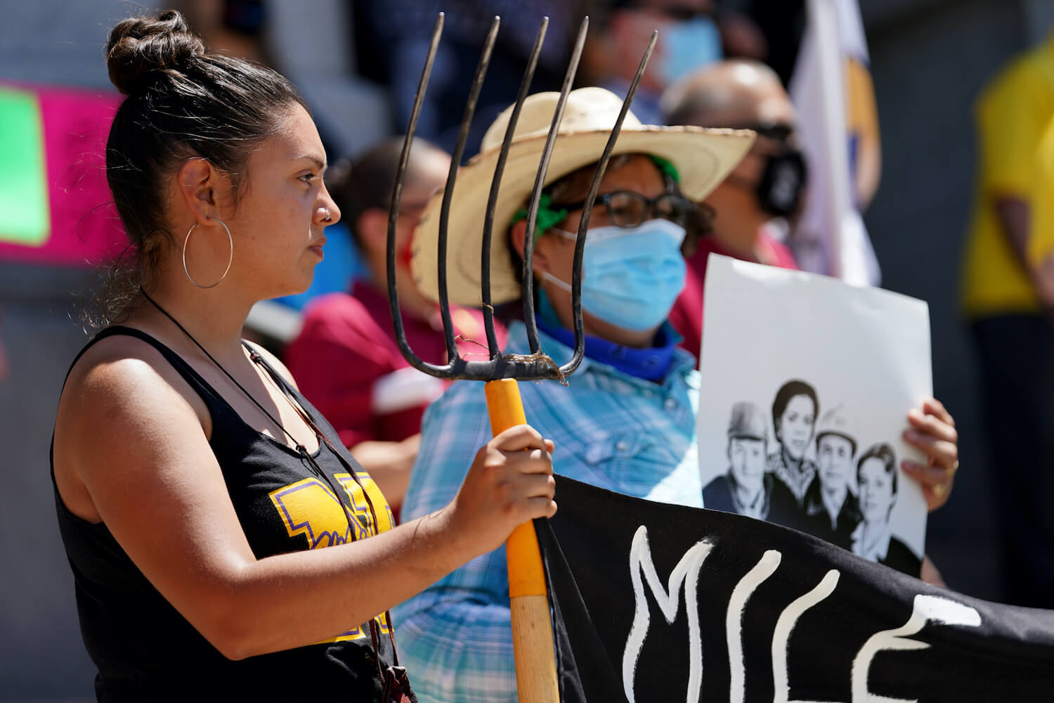 Aracely Navarro, left, stands in front of Colorado State Capitol Building for SB21-87, the Farmworker Bill of Rights, at Denver, Colorado on Thursday, May 20, 2021. June 2021