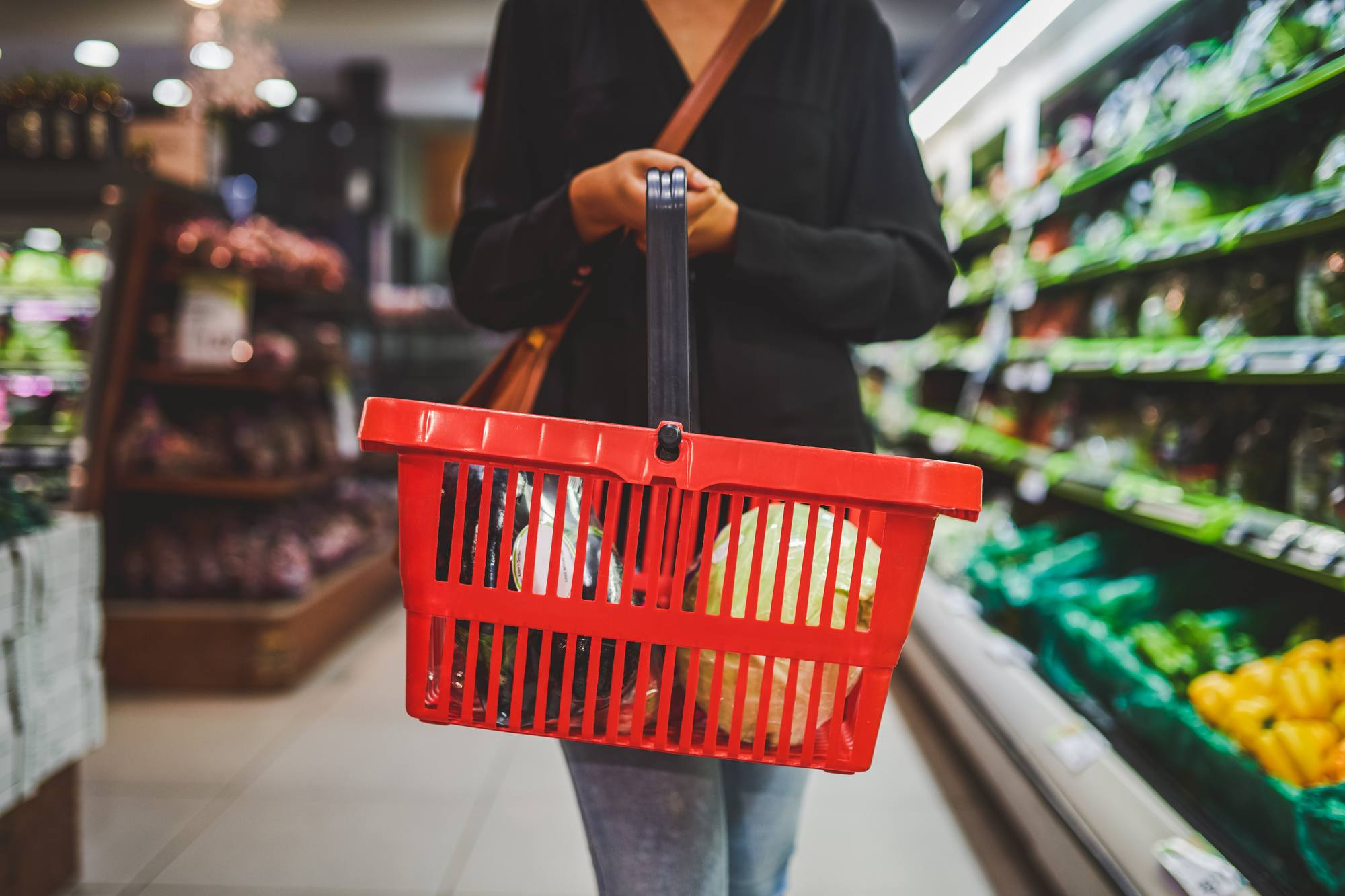 Cropped shot of a woman shopping in a grocery store. June 2021