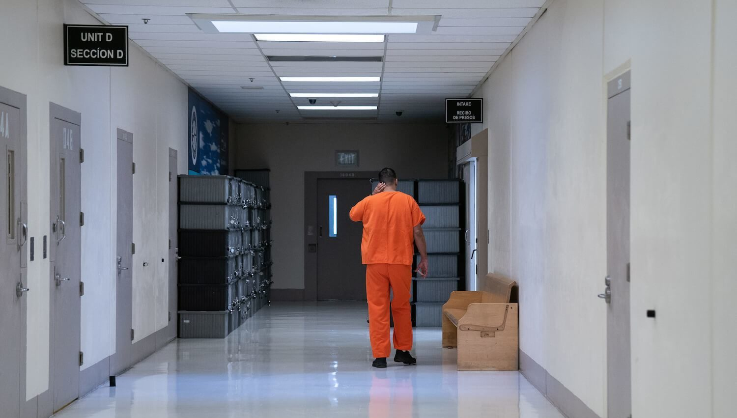 A detainee walks through the Northwest ICE Processing Center (NWIPC), formerly known as the Northwest Detention Center, during a press tour on Monday, Dec. 16, 2019. August 2021