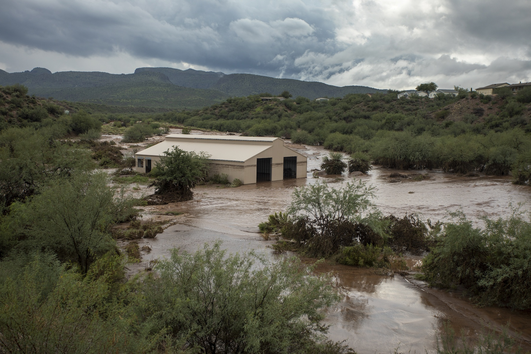 A ranch hit by a flash flood from a monsoon rainstorm, which was made worse by the quick runoff from the denuded landscape of the burn scar of a major wildfire upslope, is seen on August 18, 2021 in Roosevelt, Arizona.